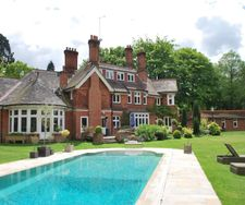 Wonderful level deck heated swimming pool superb lawns and terracing a